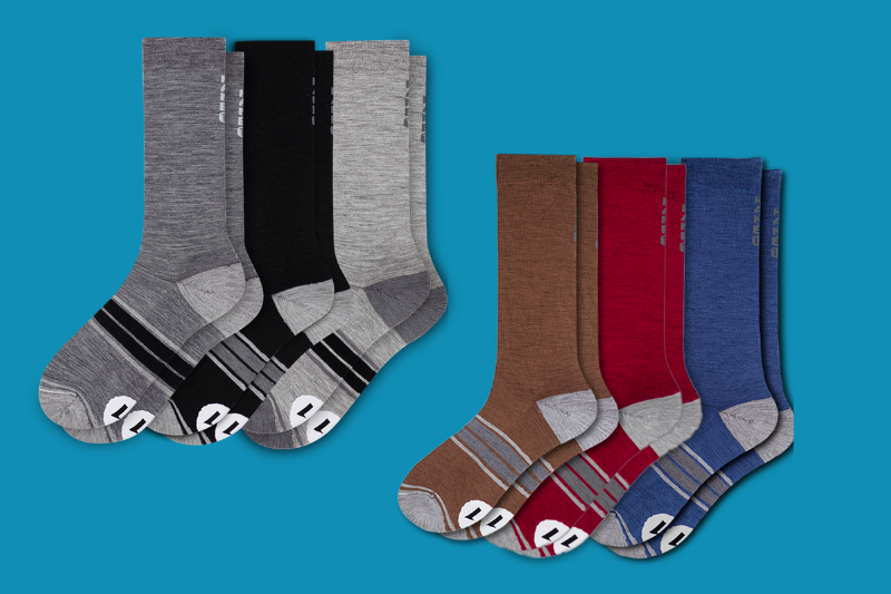 Three sets of feet with different sized socks