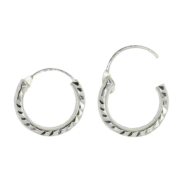 Small diamond cut sterling silver hoop earrings with continuous hinged closure
