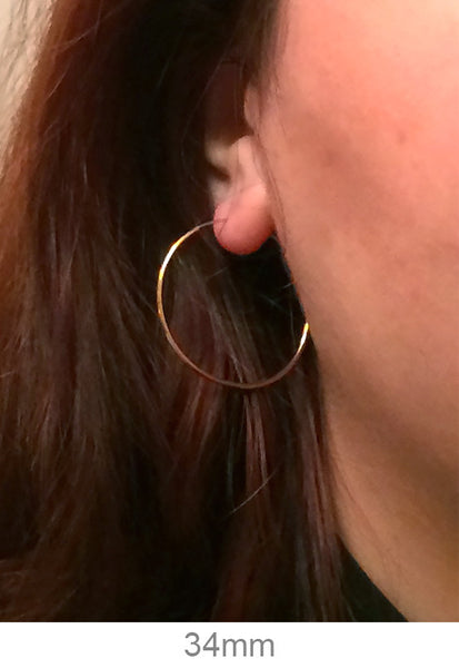 14k Yellow Gold Endless Hoop Earrings (1.25mm), All Sizes