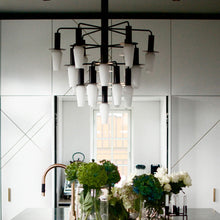 black chandelier with white bulb detailing