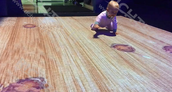 Friendly immersive physical training interactive floor system for kids in Russia