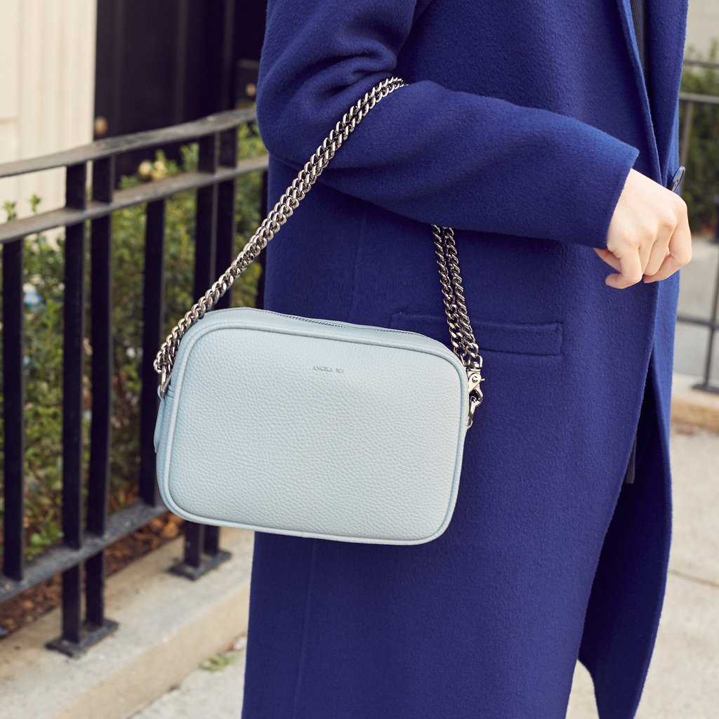 Grace Mini Cross-body in Light Nude Blue on model arm
