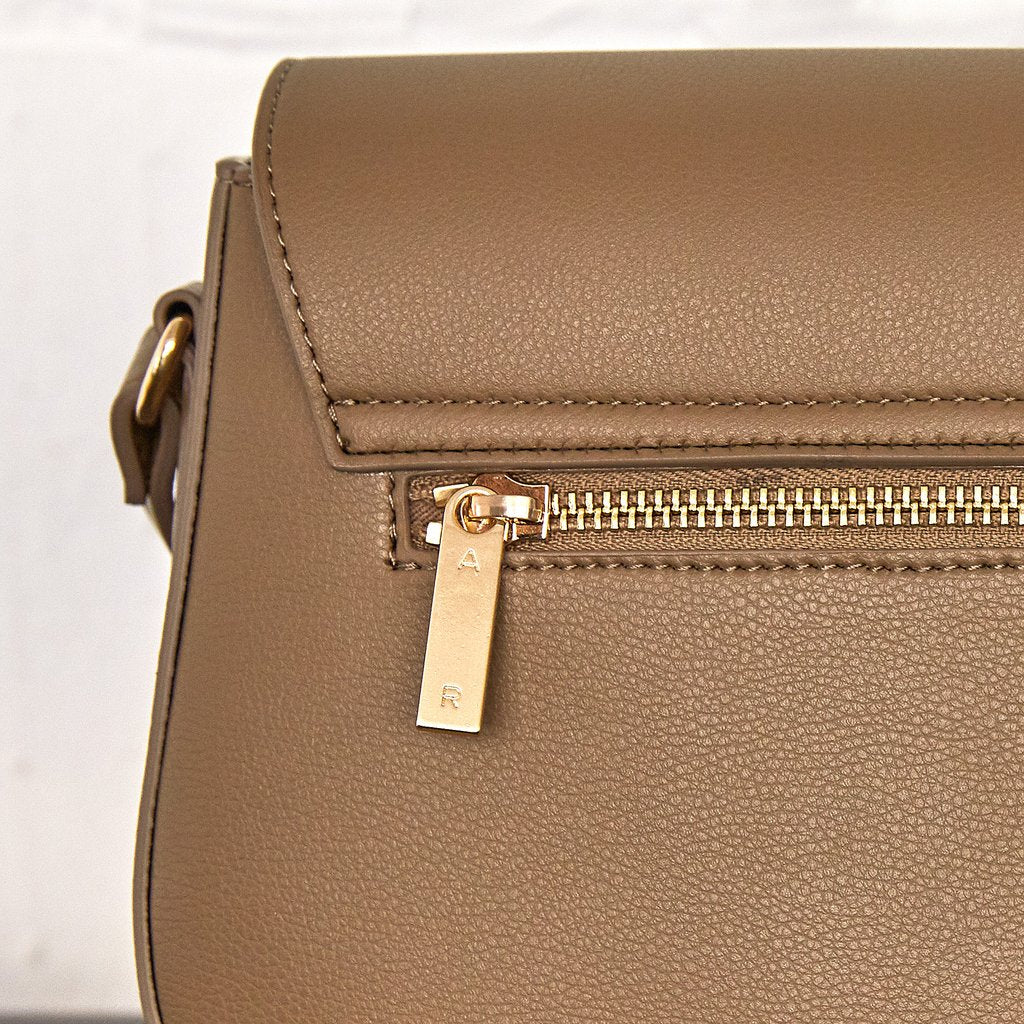 Florence Saddle Cross-Body with Signet in Mud Beige