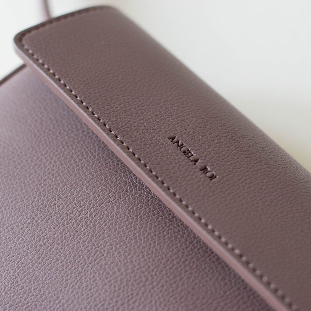 Hamilton Belt Bag / Cross-body in Ash Rose logo close up