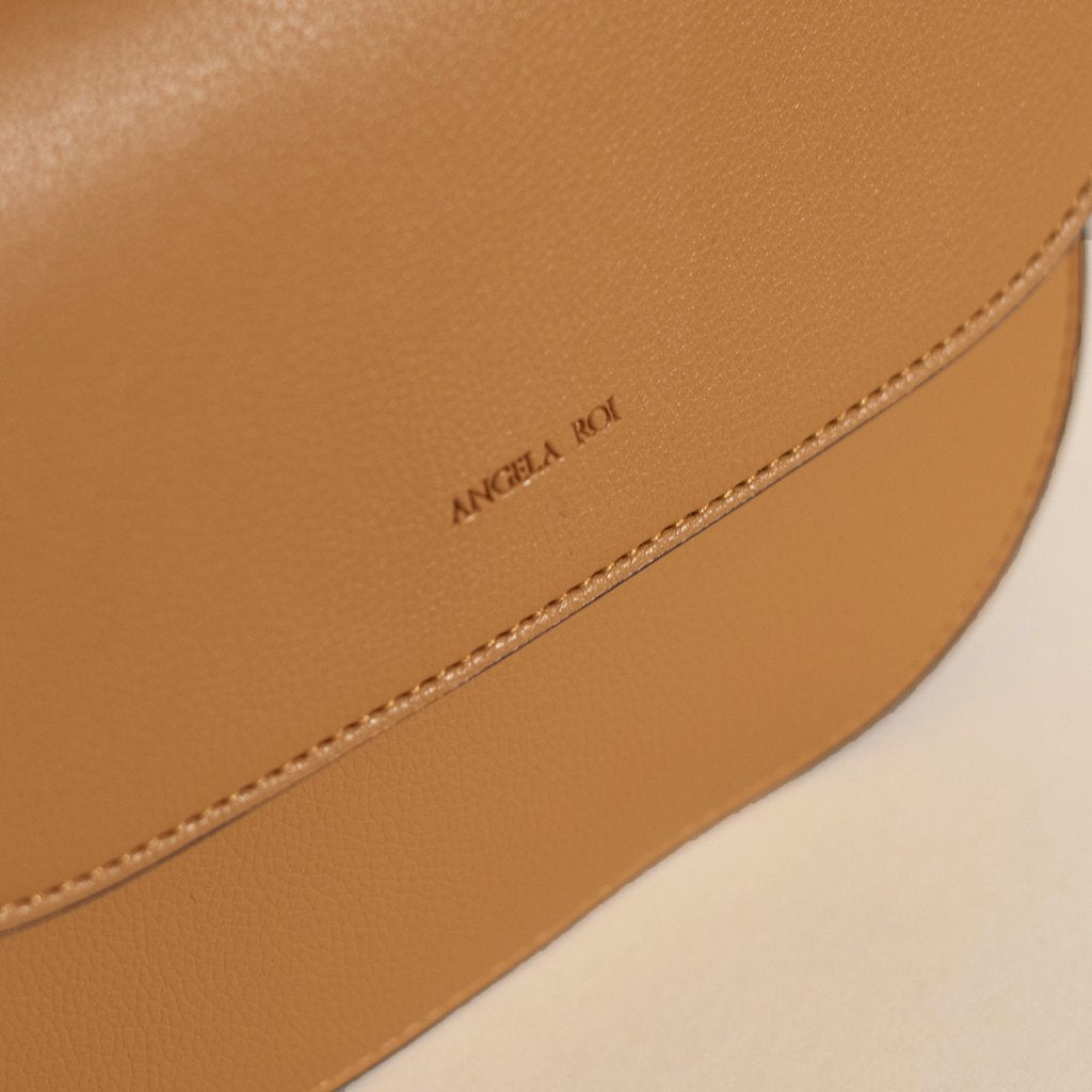 Angela Roi Vegan Hamilton Round Cross-body in Mustard, logo close up
