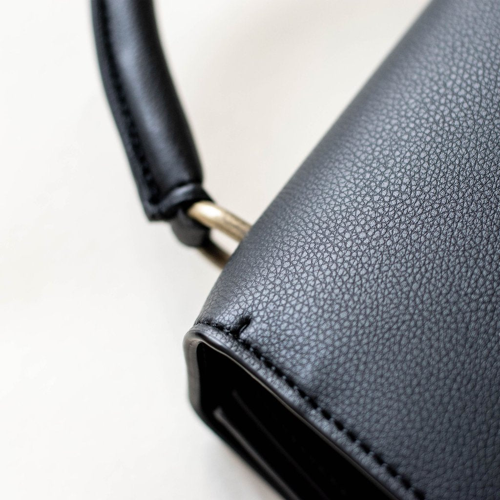 Angela Roi Vegan Hamilton Satchel in Black, handle close up