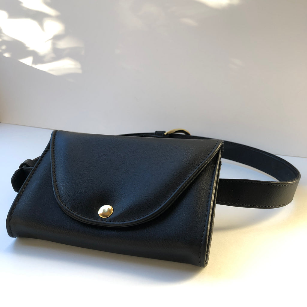 Ceibo Handcrafted Belt Bag in Black, front view with strap