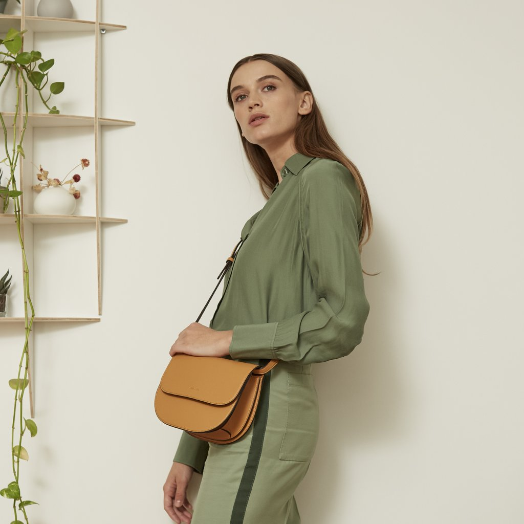 Angela Roi Vegan Hamilton Round Cross-body in Mustard, on model