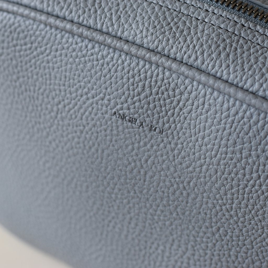 Grace Mini Cross-body in Light Nude Blue logo close up