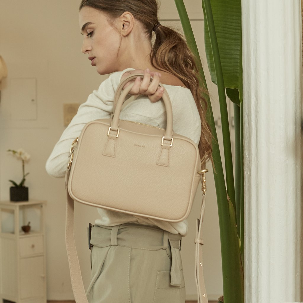 Angela Roi Vegan Barton Duffle Tote in Ecru, front view with model