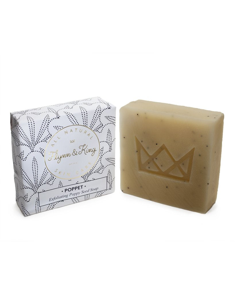 Flynn & King Poppet Exfoliating Poppy Seed Soap, 5 oz bar beside packaging