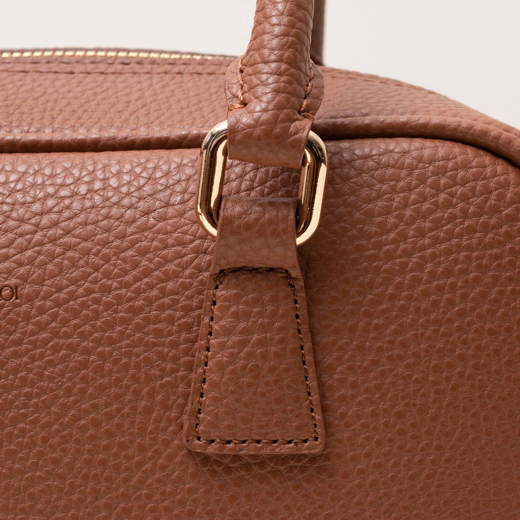 Angela Roi Barton Duffle Tote Bag in Brown, close up of hardware