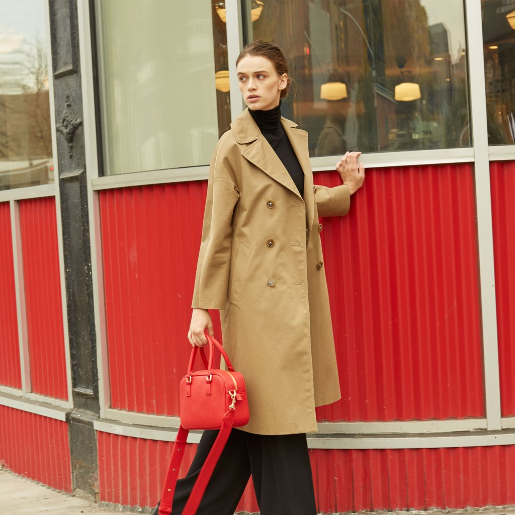 Angela Roi Vegan Barton Duffle Tote in Red, on model using handle