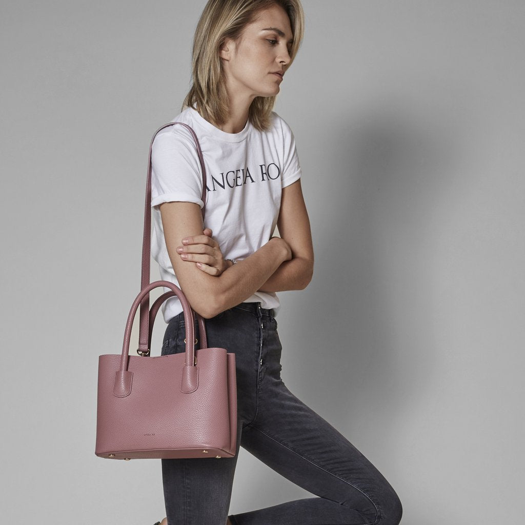 Angela Roi Vegan Cher Tote Mini in Nude Pink, on model using shoulder strap