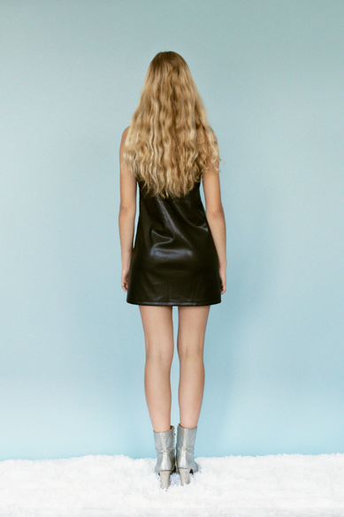 Model wearing Ashley Vegan Leather Jumper by Dolores Haze, Back view