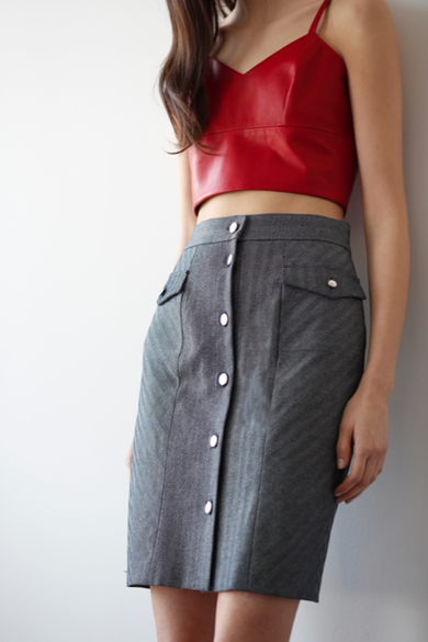 Model wearing Penelope Denim Skirt by Dolores Haze with red crop top