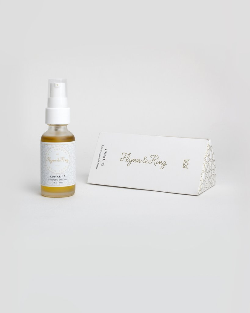 Flynn & King Lunar 13 Restorative Oil Elixir, bottle beside box