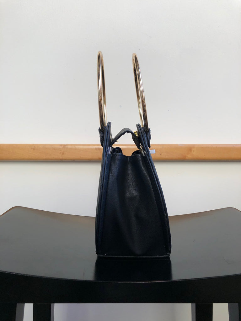 Ceibo Handcrafted Ring Bag in Black, side view