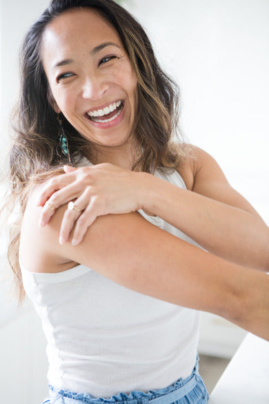 Samudra Skin & Sea Body Butter, being used by smiling model