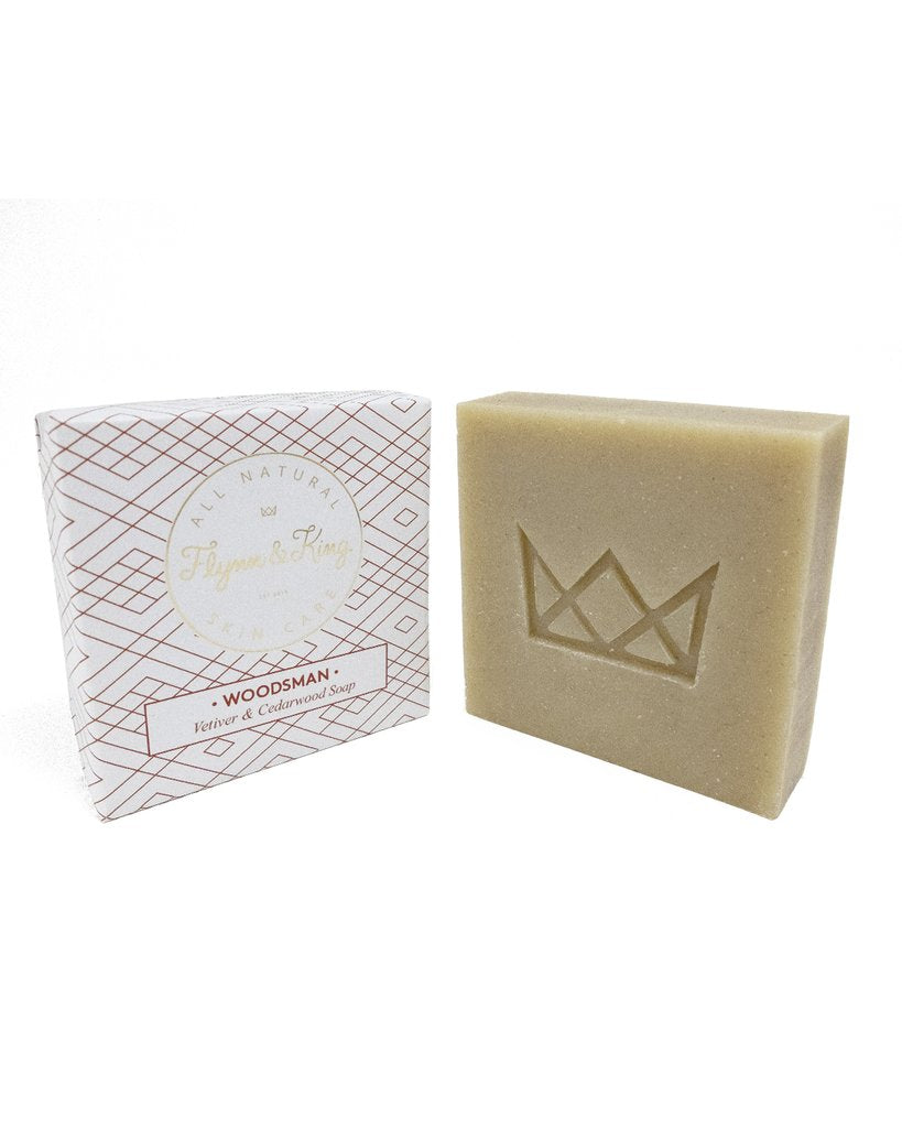 Flynn & King Woodsman - Vetiver & Cedarwood Soap, 5 oz bar next to packaging