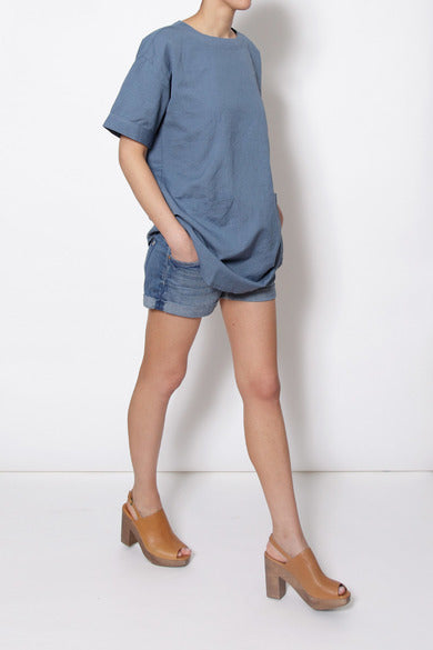 Thinking Mu Linen tunic on model walking