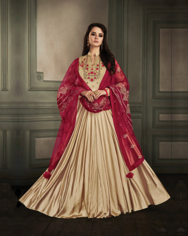 Beige Colored Partywear Embroidered Georgette Satin Anarkali Suit With Net Dupatta