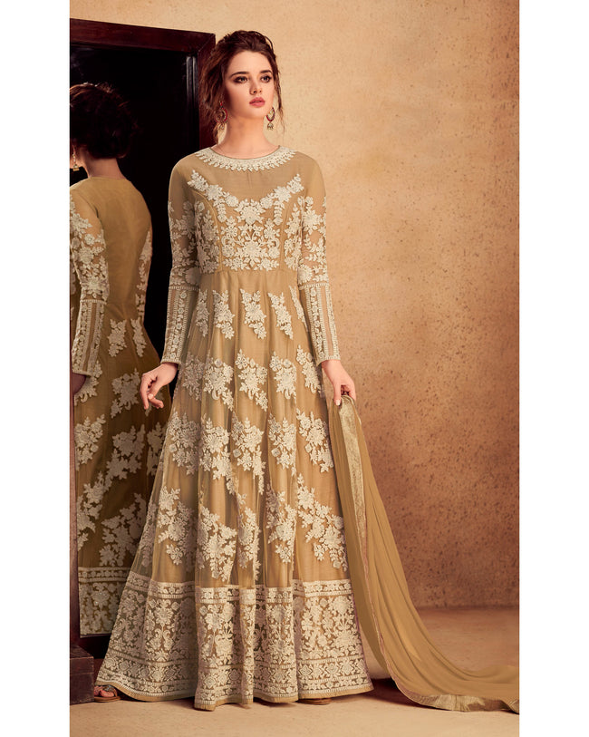 Beige Colored Partywear Embroidered Silk & Net Semi Stitched Anarkali Suit