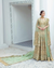 Green Colored Bridal Wear Unstitched Heavy Pakistani Salwar Kameez Suits