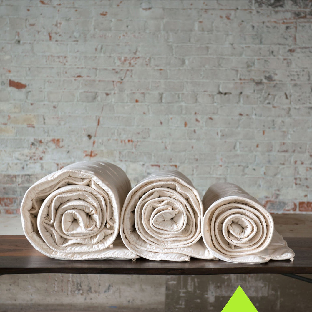 Comparison picture of three Obasan Organic Wool Comforters in each weight: Light, Midweight, and Heavy.