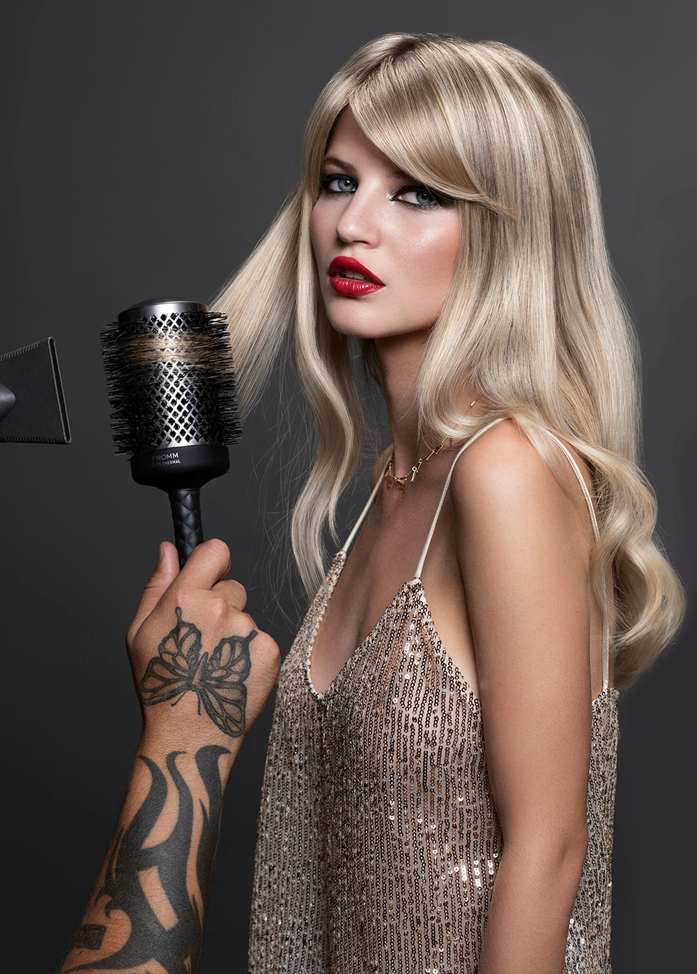 Fromm Pro Professional Salon Elite Thermal Black Ceramic Round Hair Brush used on blonde model with curls, red lipstick, and gold sequin top