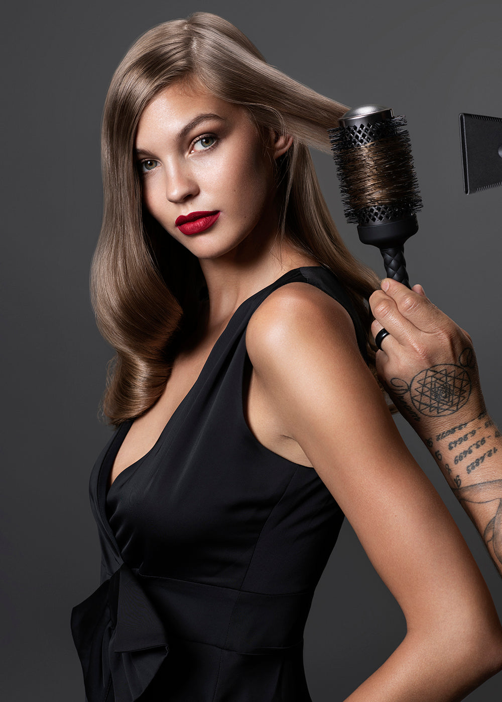 Fromm Pro Professional Salon Elite Thermal Black Ceramic Round Hair Brush used on blonde model with curls, red lipstick, and black dress