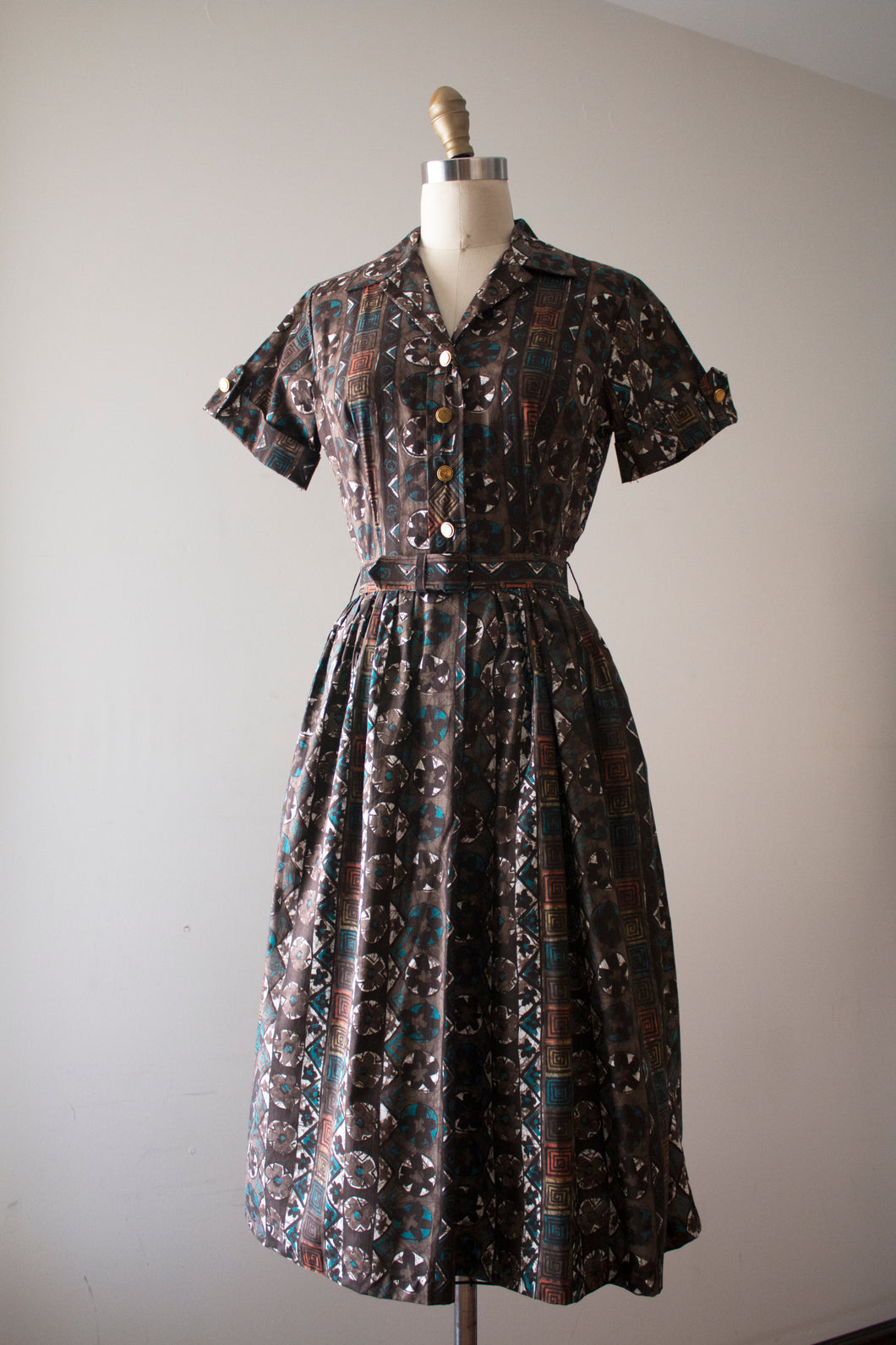 vintage 1950s shirtwaist dress with midcentury print