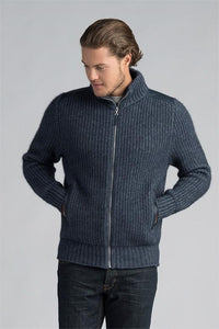 Possum and Merino  This timeless jacket features a chunky fisherman's rib knit structure with New Zealand deer patches on the shoulders and pocket trims.  A classic piece that will never go out of style.