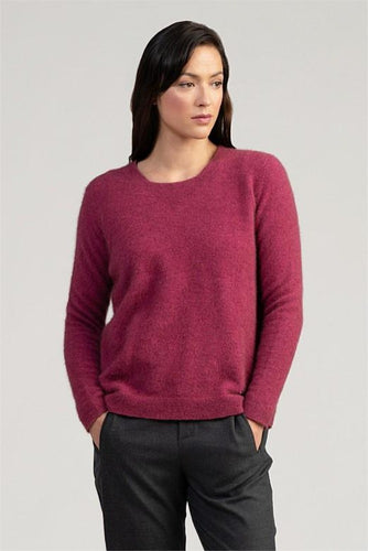 Possum and Merino  This sweater is simple, casual and elegant.  The refined garter stitch neck detail features a'v' shaped finish.  Shaped fitted sleeves complement a slightly looser fit through the body to create the perfect 'relaxed' silhouette.  Finished beautifully with the Merinomink branding bar.