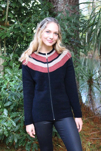 Possum and Merino.  Striking curved stripes in shoulder area draw the eye.  Longer length sleeves with cuffs that can be turned back or worn flat on a longer arm.