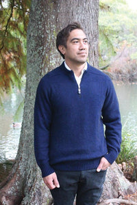 Possum and Merino.  A slimline profile plain jumper with 1/4 zip - sure to be a wardrobe staple.