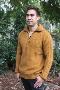 Possum and Merino.  This heavyweight chunky jumper is super warm.  All over moss stitch is accented by cable detail on the chest and sleeves.