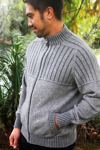 Possum and Merino.  Roll detail across chest and contrast yarn plated into shoulder area and cuffs.