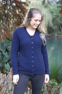 Possum and Merino.  Classic V-neck button cardigan with turnback cuffs.
