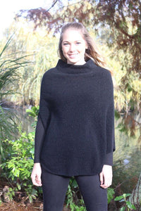 softly draped turtleneck poncho with lace detail in neck/shoulder area.