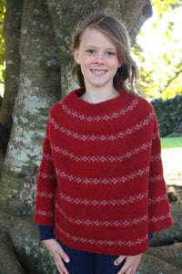 Possum and Merino.  Generous poncho featuring contrast colour motif.  For the colours Lagoon and Teal the white motif is Angora and Merino yarn and for the colour Red the pink motif is Possum and Merino yarn.