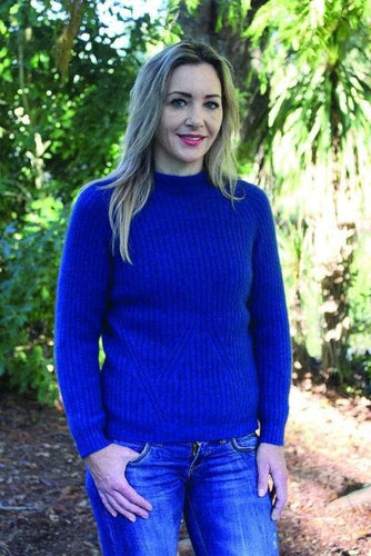 Possum and Merino.  Turtle neck jumper with shaped rib detail in waist area on both the front and back of the garment.