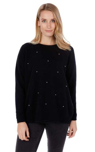 Delicate pearl embelishment on this classic, loose fit raglan sweater creates a timeless piece.