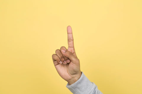 Hand with one finger up