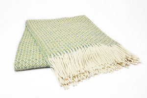 Asterlark merino wool throw blanket in yellow and green with flower weave pattern