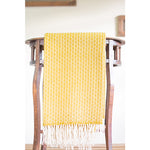 Asterlark merino wool throw blanket in yellow with flower weave pattern