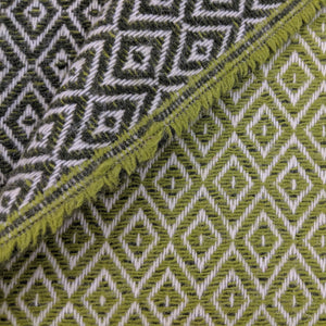 Asterlark merino wool blanket in dark green and light green with double diamond weave pattern