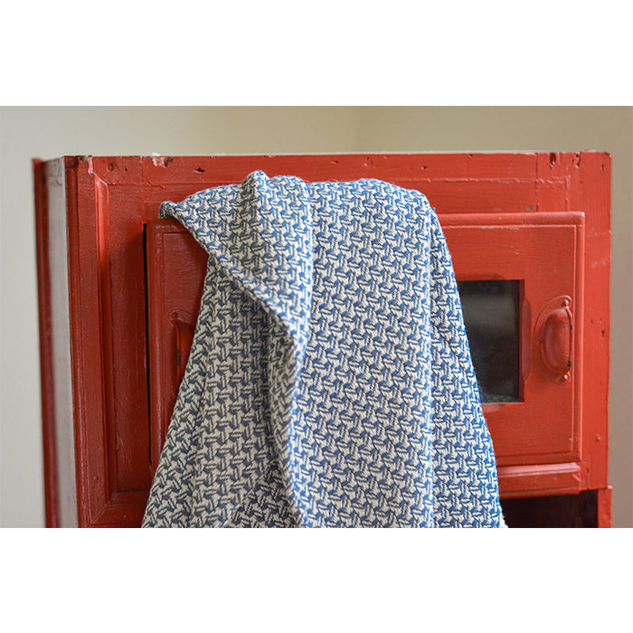 Asterlark 100% cotton throw blanket in blue with wing weave pattern