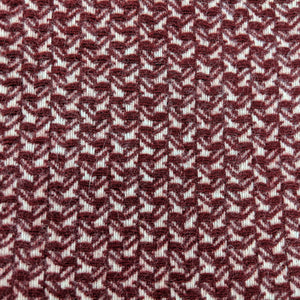 Asterlark merino wool throw blanket in ruby with wing weave pattern