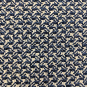Asterlark merino wool throw blanket in shades of dark blue with wing weave pattern